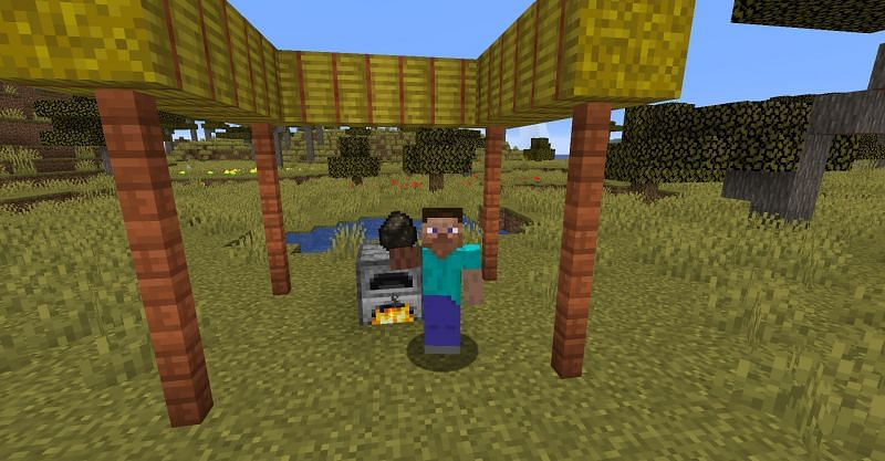 Steve holding up a piece of charcoal in Minecraft (Image via Minecraft)