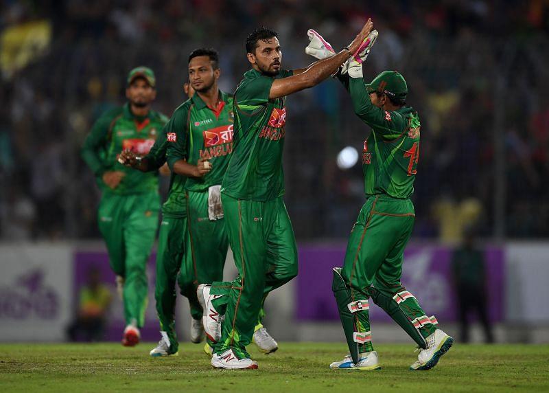 Mashrafe Mortaza celebrating a fall of a wicket with his teammates