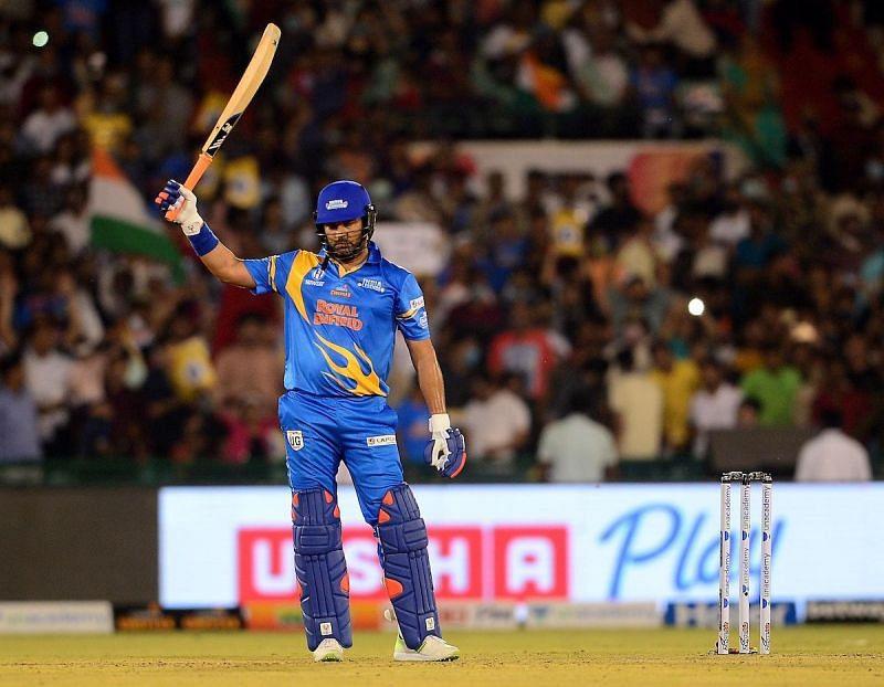 Yuvraj Singh celebrates his half-century