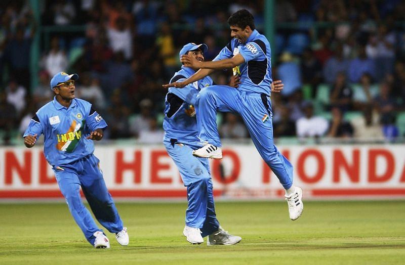 Ashish Nehra of India celebrates the wicket of Craig White of England.