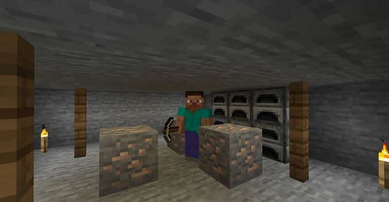 Steve preparing to smelt the iron ore that he found in Minecraft. (Image via Minecraft)