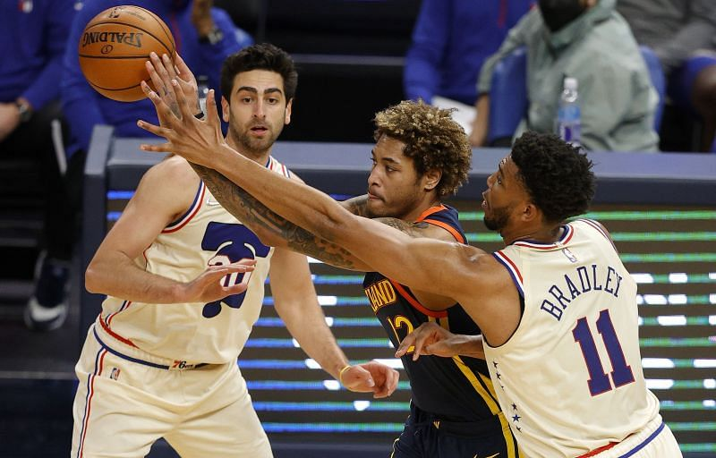 Kelly Oubre (middle) attempts a tough shot