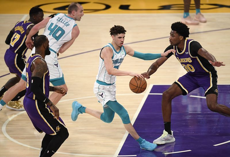 LaMelo Ball #2 dribbles in front of Damian Jones #30. (Photo by Harry How/Getty Images)