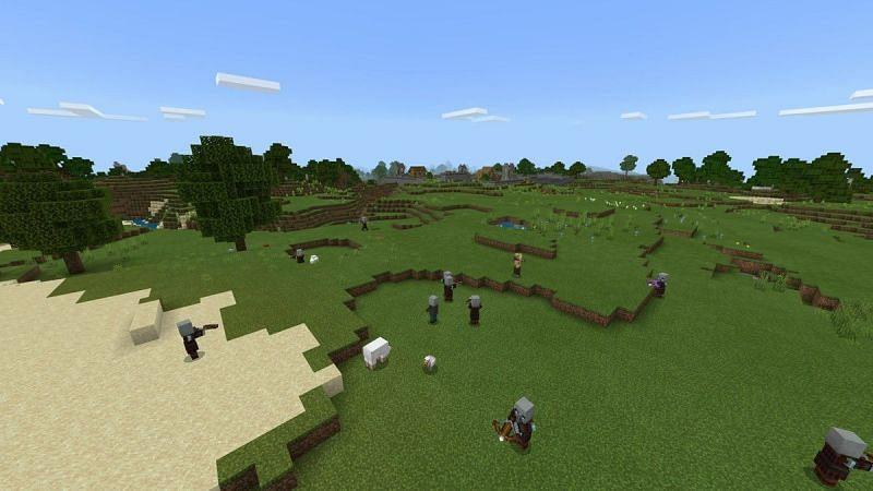 A raid party attacking a village (Image via Minecraft)