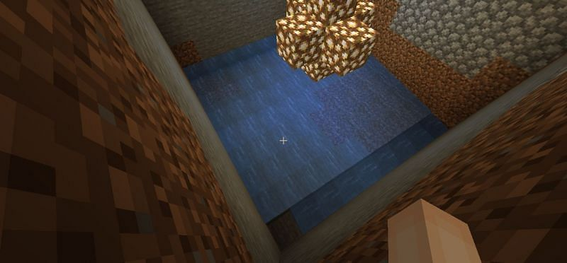The hole filled with water (Image via Minecraft)