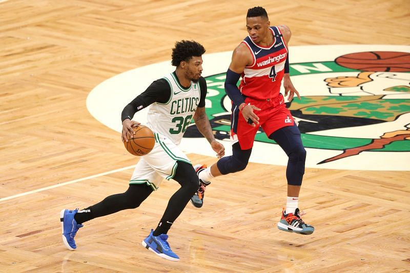 Marcus Smart #36 of the Boston Celtics (L) in action