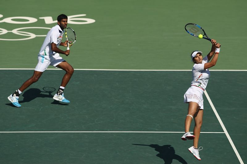 Rohan Bopanna and Sania Mirza, of India, during the mixed doubles bronze medal match against Radek Stepanek and Lucie Hradecka of the Czech Republic at the Rio 2016 Olympic Games