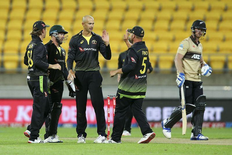 Ashton Agar celebrates a wicket with teammates.