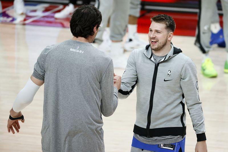 Luka Doncic and Boban Marjanovic of the Dallas Mavericks