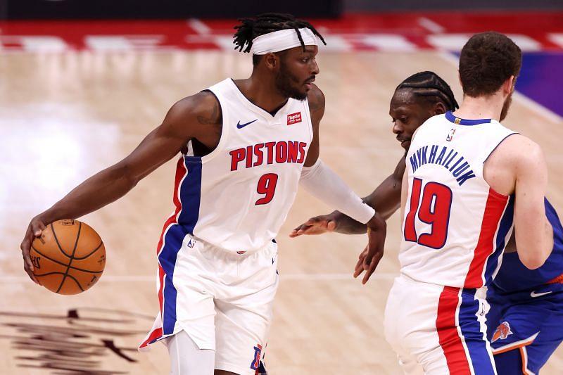 Jerami Grant #9 (left) of the Detroit Pistons