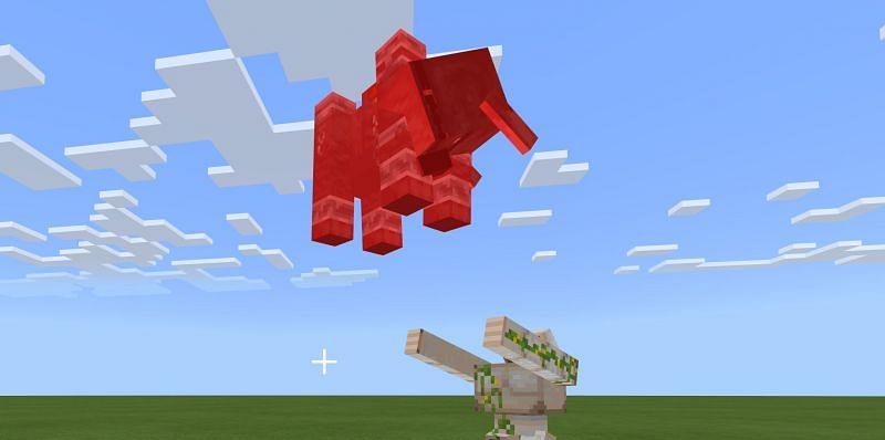 Iron Golem Attacking a Ravager (Image via Minecraft)