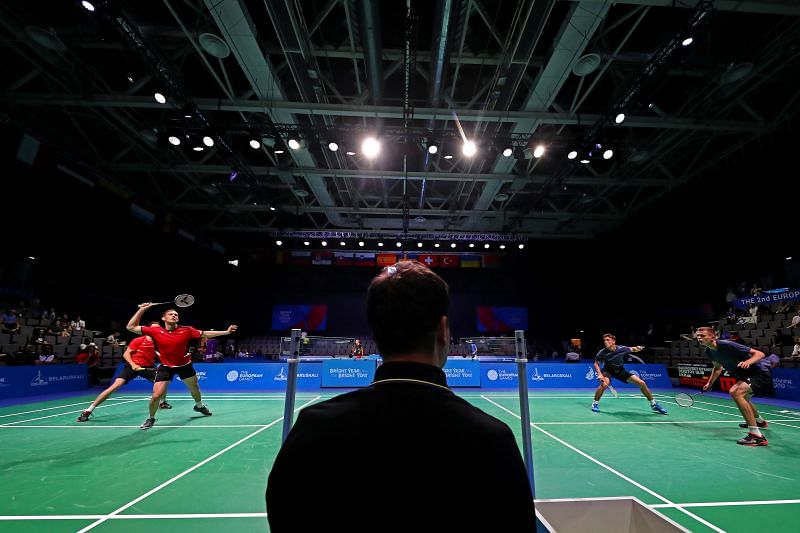 A badminton doubles match in progress