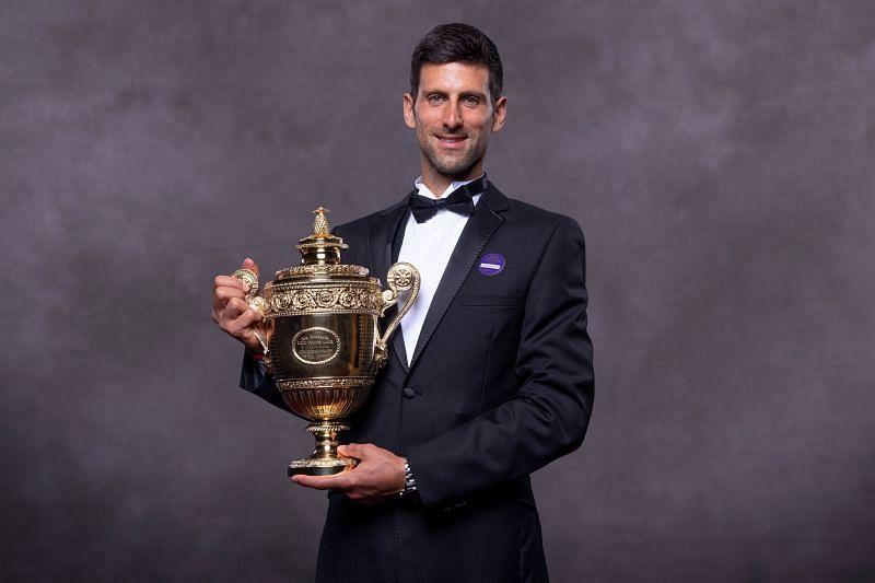 Novak Djokovic with his 2019 Wimbledon title.