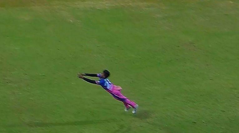 Chetan Sakariya takes a flying catch to dismiss Nicholas Pooran of PBKS