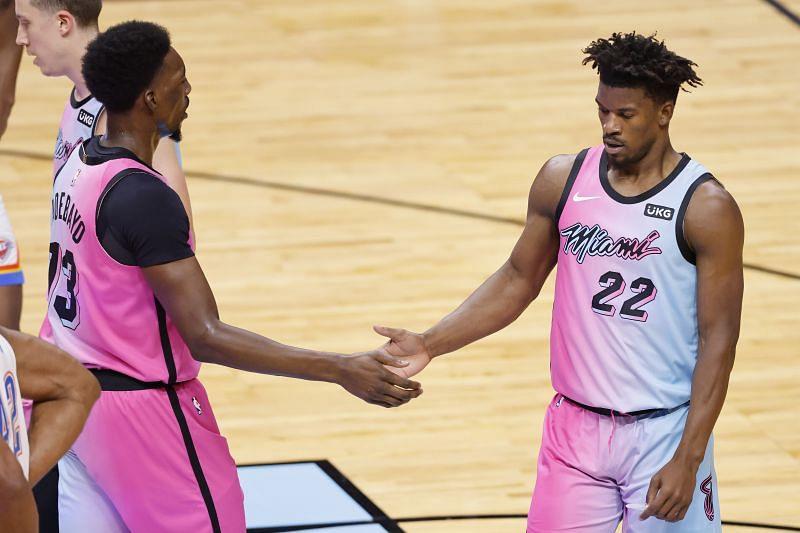 Bam Adebayo #13 and Jimmy Butler #22 of the Miami Heat