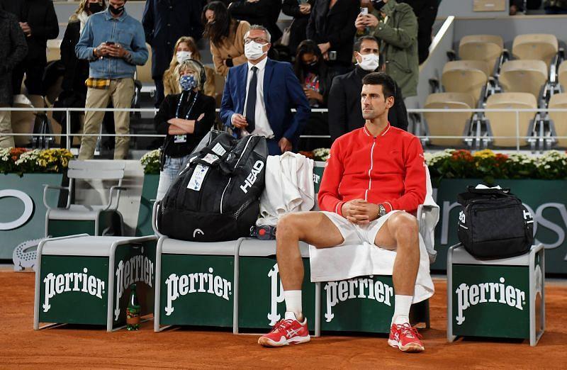 Novak Djokovic looks on after losing to Rafael Nadal at last year