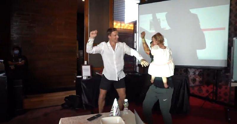 Jos Buttler (L) celebrating his daughter