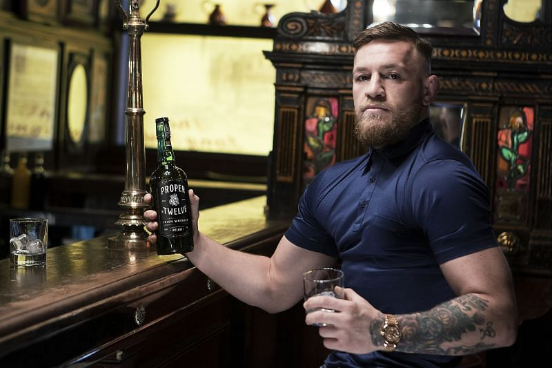 Conor McGregor with a bottle of Proper No. 12 Irish Whiskey