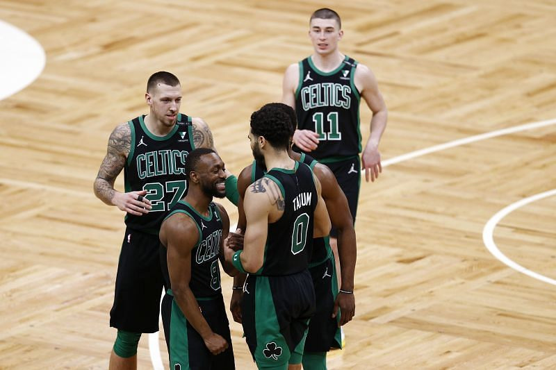 Jayson Tatum #0 celebrates with Kemba Walker #8, Daniel Theis #27 and Payton Pritchard #11