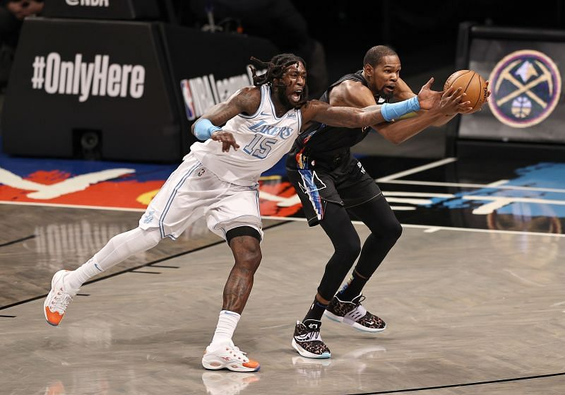 Montrezl Harrell #15 and Kevin Durant #7 fight for the ball.