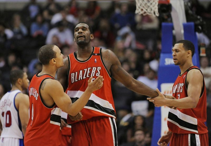 Greg Oden #52 of the Portland Trail Blazers celebrates with Brandon Roy #7 and Jerryd Bayless #4.