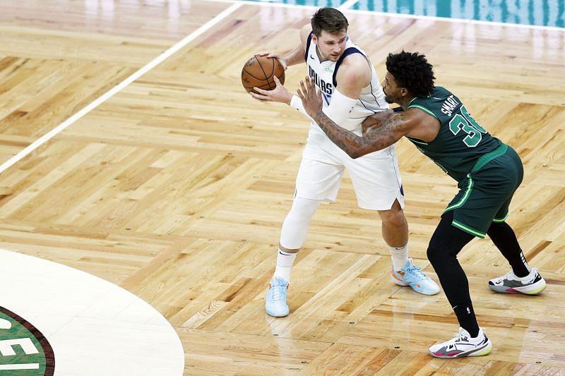 Marcus Smart #36 of the Boston Celtics defends Luka Doncic #77 of the Dallas Mavericks.