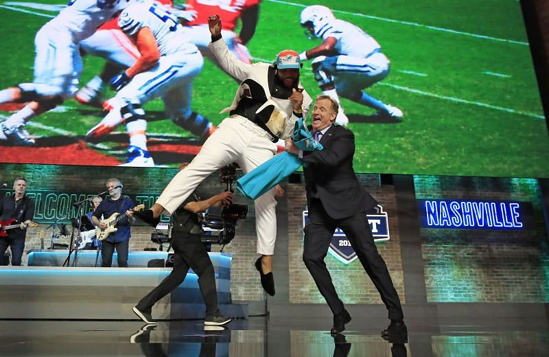 Christian Wilkins celebrates with Roger Goodell during the 2019 NFL Draft
