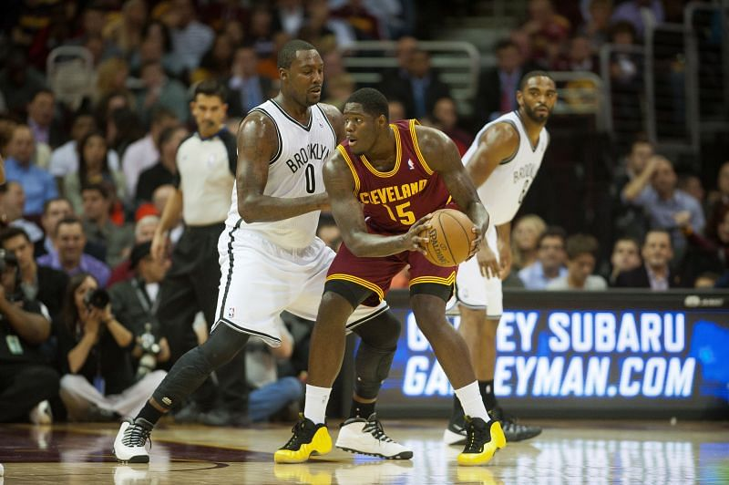 Anthony Bennett #15 looks for a pass against the Brooklyn Nets. Michael Olowokandi #34 dribbles the ball in a game versus the Bucks.