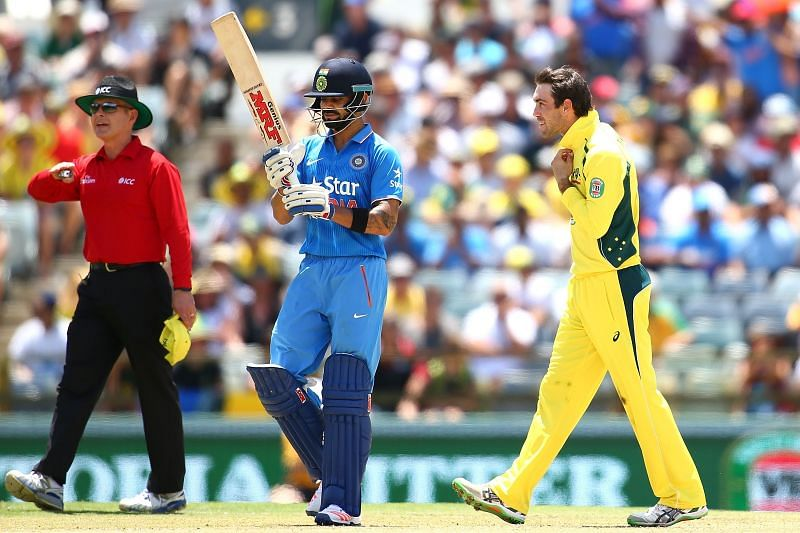 Virat Kohli (L) & Glenn Maxwell in their national colors.