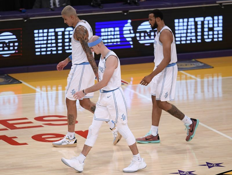 Kyle Kuzma #0, Alex Caruso #4 and Talen Horton-Tucker #5 leave the floor after a timeout.