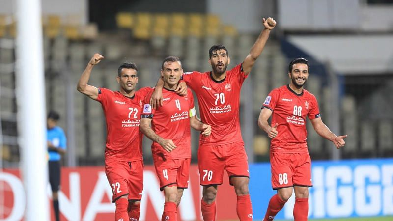 Persepolis FC players Isa Al Kasir, Jalal Hosseini, Shahriyar Moghanloo, and Siamak Nemati (from left to right) celebrate after scoring against FC Goa in their 2021 AFC Champions League match (Image Courtesy: AFC website)