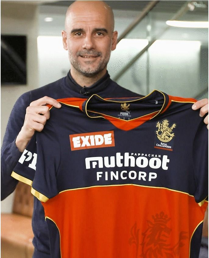 Manchester City manager Pep Guardiola showing off the RCB jersey