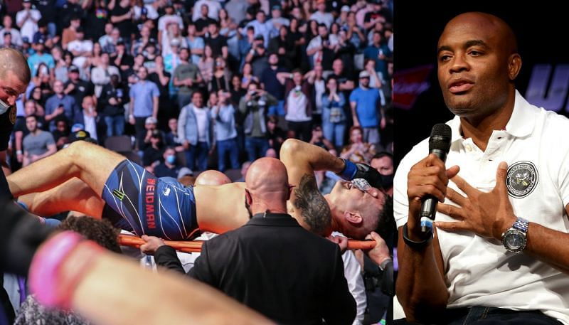 Anderson Silva (R) reacts to Chris Weidman