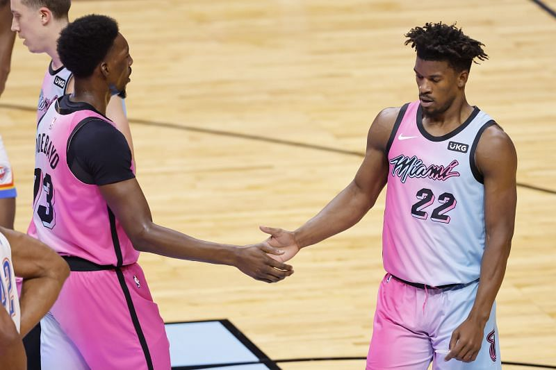 Bam Adebayo #13 and Jimmy Butler #22 celebrate a play against the Thunder.