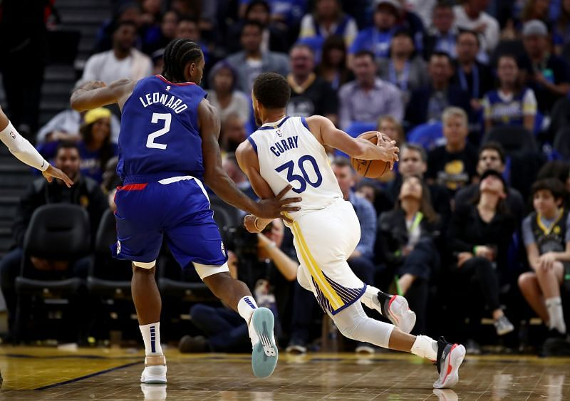 Stephen Curry #30 of the Golden State Warriors is guarded by Kawhi Leonard #2 of the LA Clippers.