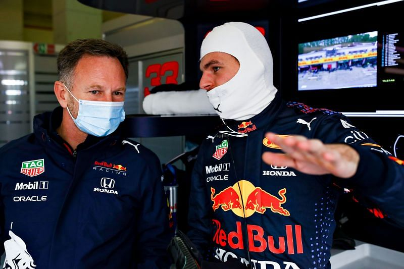 Max Verstappen of Red Bull Racing and Team Principal Christian Horner chat in the garage during 2021 Imola GP practice. (Photo by Mark Thompson/Getty Images)