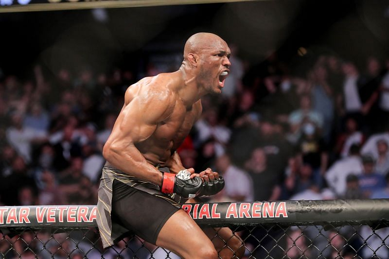Kamaru Usman celebrates his win at UFC 261