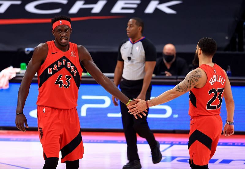 Pascal Siakam #43 is congratulated by Fred VanVleet #23.