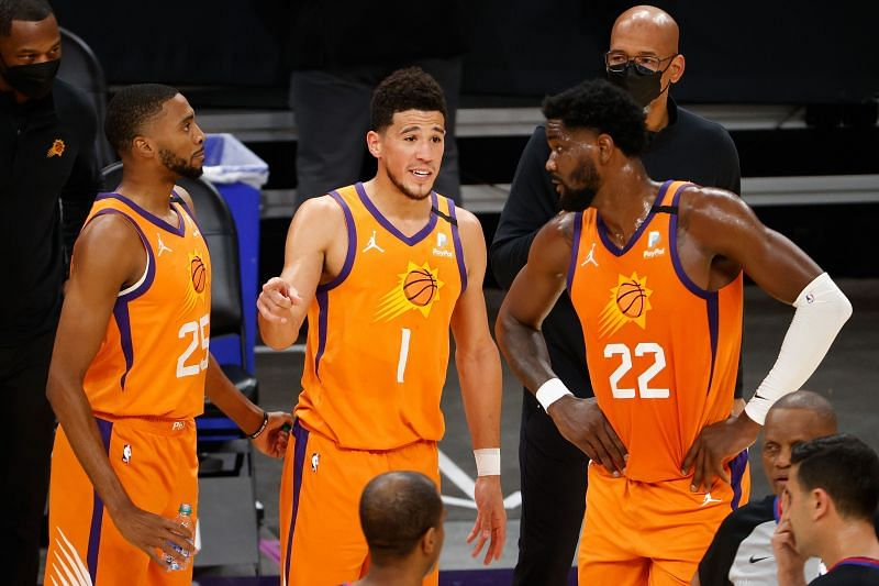 Devin Booker #1 of talks with Mikal Bridges #25 and Deandre Ayton #22.