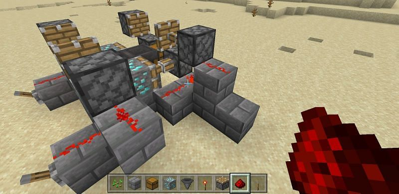 Finally you will place two sets of pistons on either side of your contraption slightly above your diamond ore.
