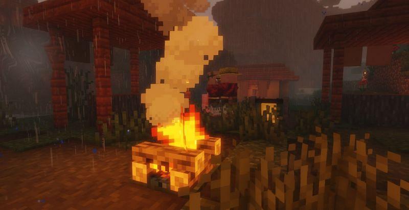 Aldeanos de Minecraft parados alrededor de un fuego bajo la lluvia (Imagen a través de Minecraft)