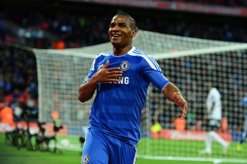 Florent Malouda celebrates a goal for Chelsea.