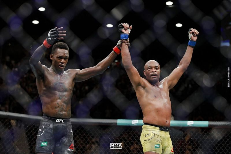 Anderson Silva (right) with Israel Adesanya