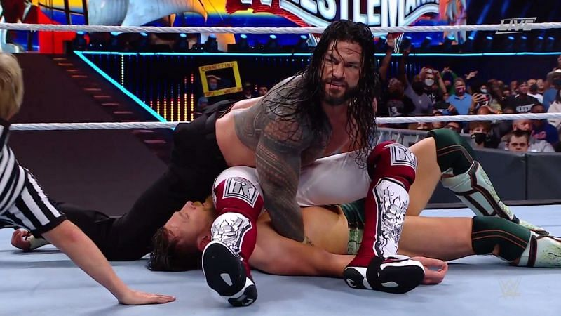 Roman Reigns pinned Daniel Bryan and Edge at the same time
