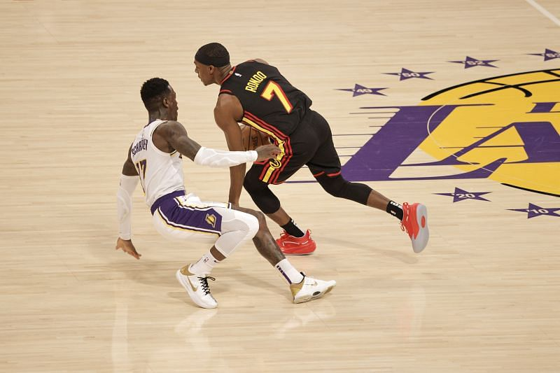 Rajon Rondo #7 of the Atlanta Hawks drives against Dennis Schroder #17 of the Los Angeles Lakers