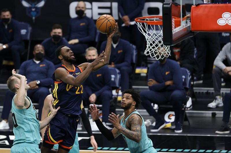 Andrew Wiggins of Golden State Warriors attempts a layup against the Hornets