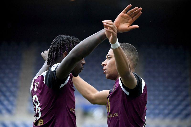 Kylian Mbappe celebrates with Moise Kean