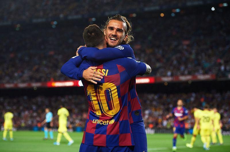 Lionel Messi (L) and Antoine Greizmann
