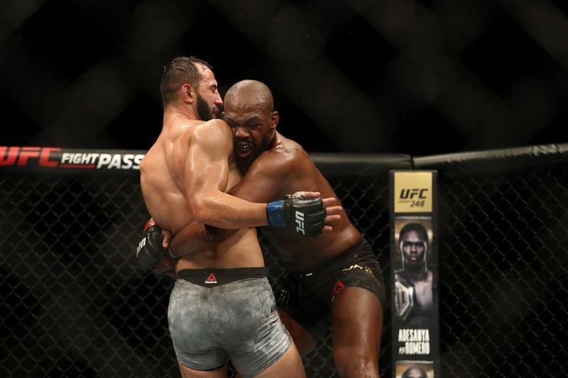 Jon Jones attempts a takedown on Dominick Reyes.