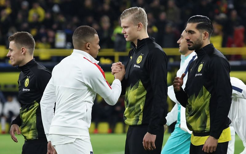Kylian Mbappe and Erling Haaland greet each other before a game